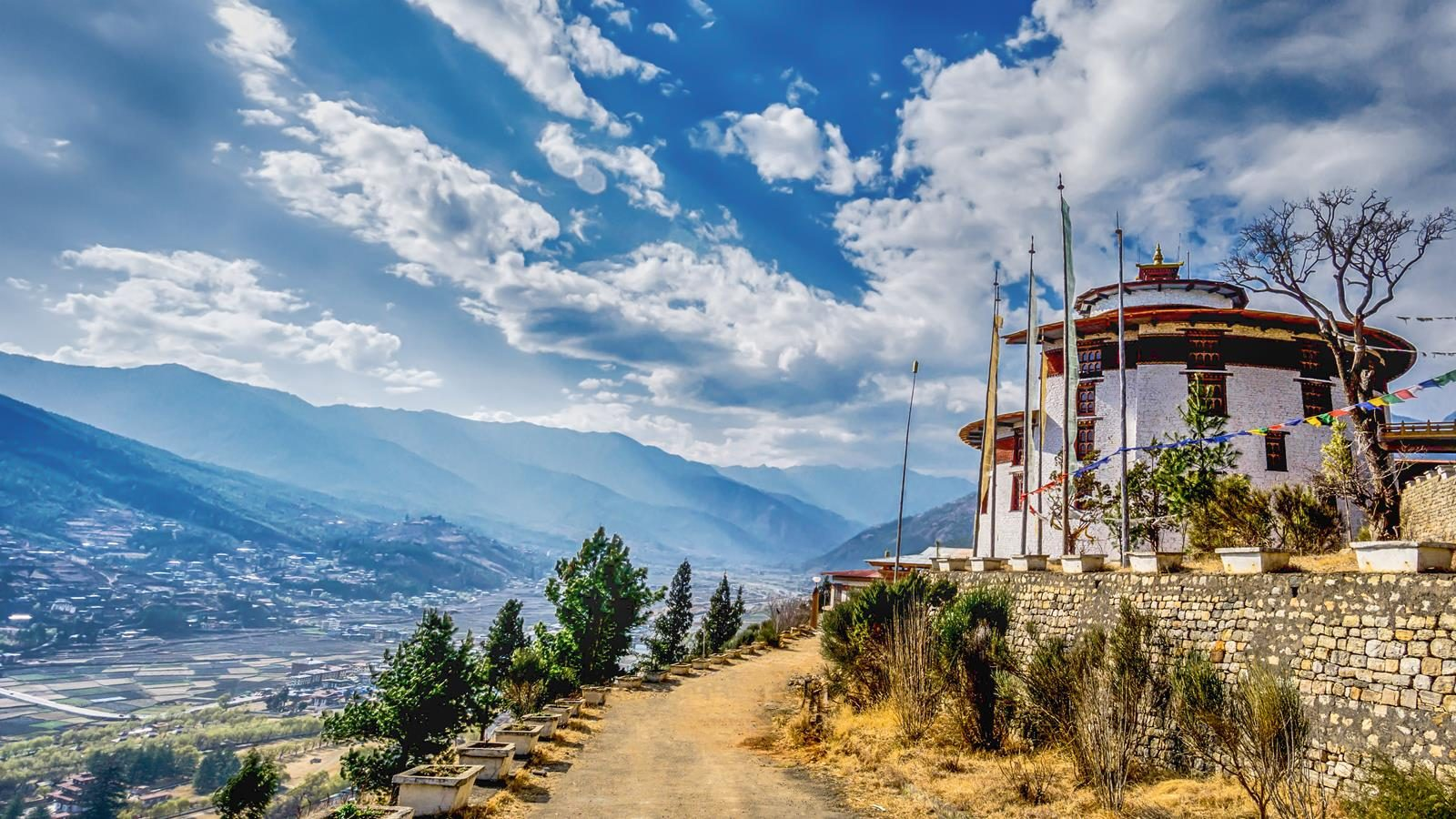 Mountain Village with rural road on a Sunny Summer day, Bhutan